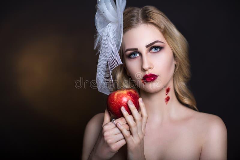 Kvinna med Apple arkivbild
