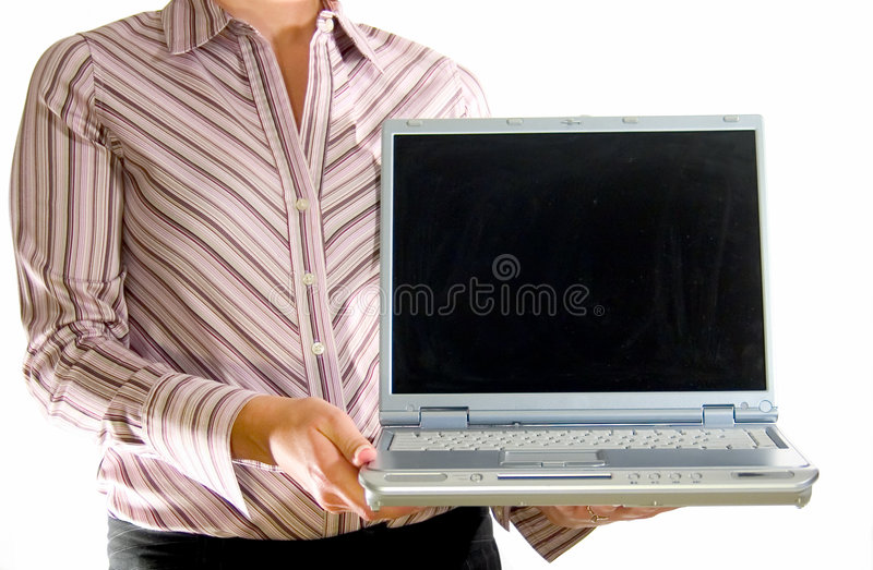 Kvinna med bärbar dator fotografering för bildbyråer