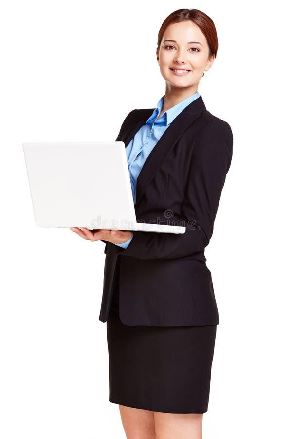 Kvinna med bärbara datorn royaltyfri foto