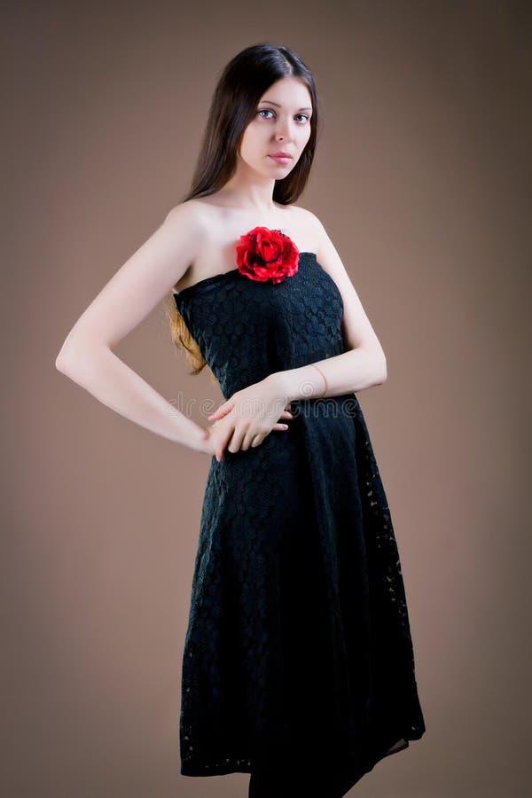 Kvinna med blomman arkivbild