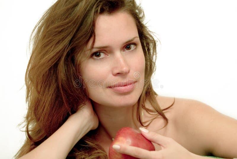 Kvinna med det röda äpplet arkivbild