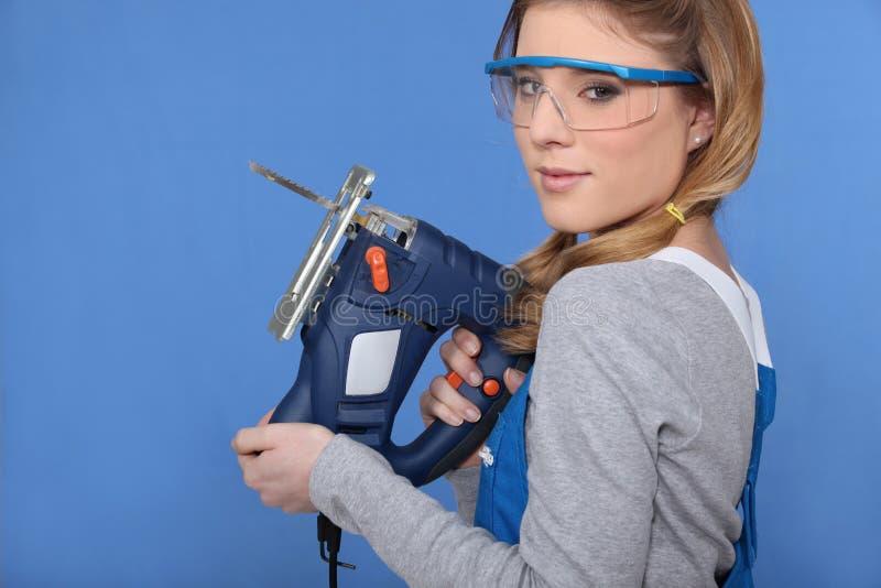 Kvinna med en jigsaw royaltyfri fotografi