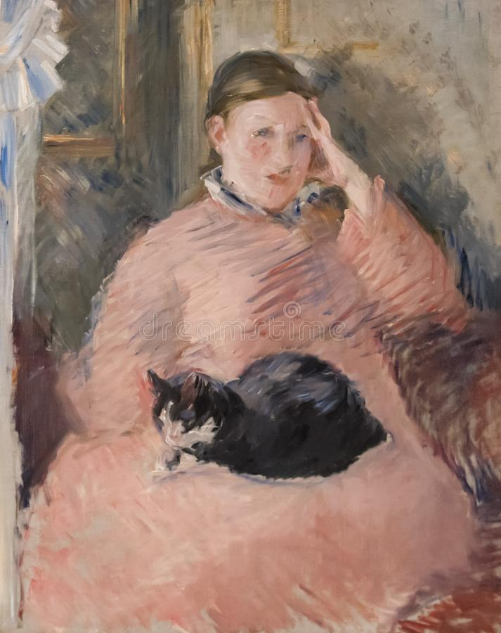 Kvinna med en katt som målar vid Eduard Monet arkivfoton