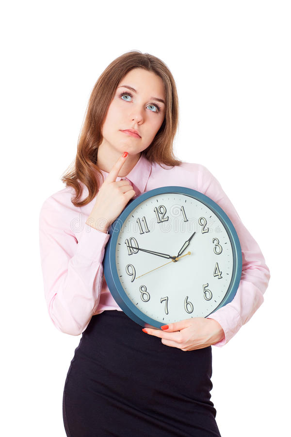 Kvinna med en klocka i hans tänka för händer fotografering för bildbyråer