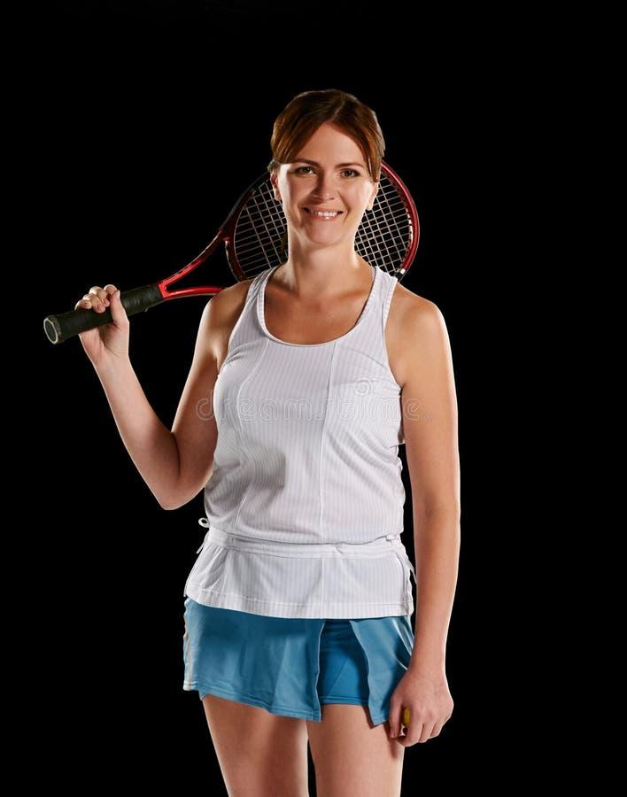 Kvinna med en tennisracket royaltyfri bild