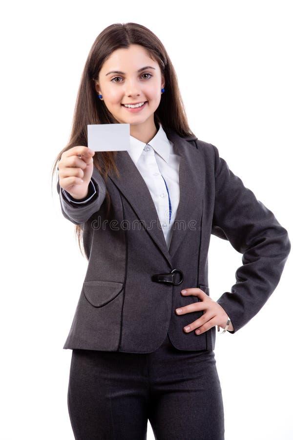 Kvinna med ett affärskort royaltyfri bild