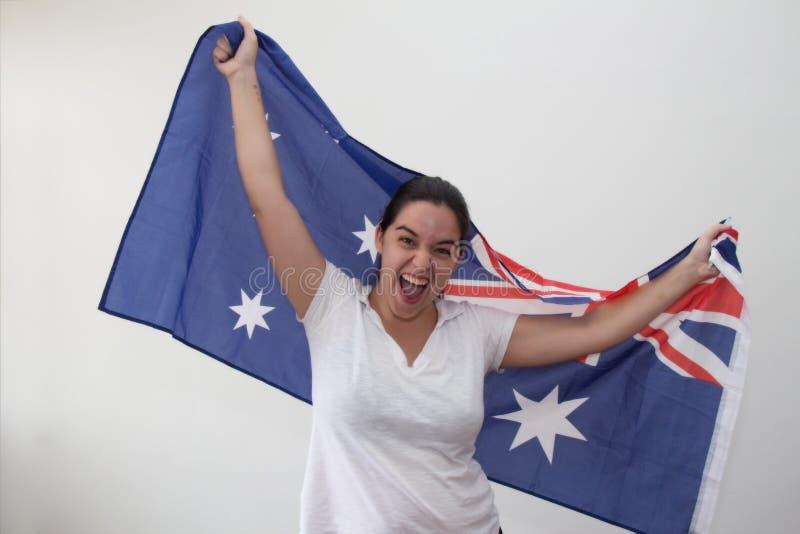 Kvinna med flaggan i den vita bakgrunden arkivfoton