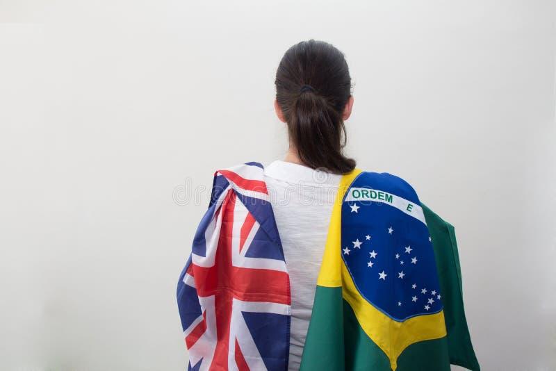 Kvinna med flaggor i den vita bakgrunden royaltyfria bilder