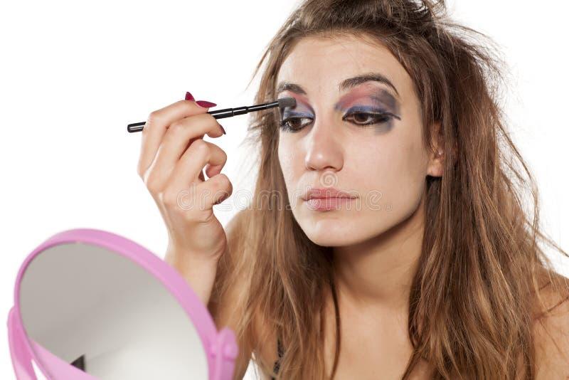 Kvinna med ful makeup royaltyfria bilder