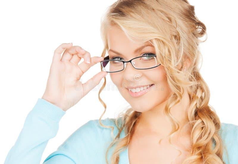 Kvinna med glasögon royaltyfria bilder