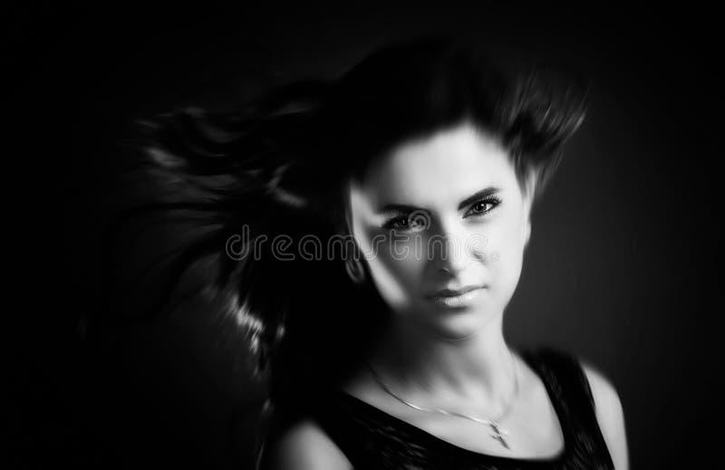 Kvinna med hårflyg arkivbild
