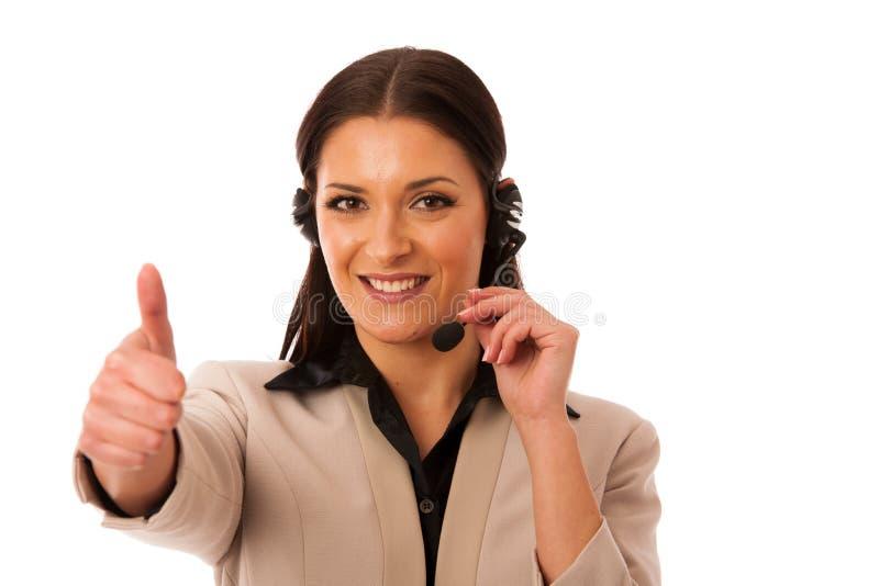Kvinna med hörlurar med mikrofon och mikrofonen som arbetar i appellmitten för hel royaltyfri foto