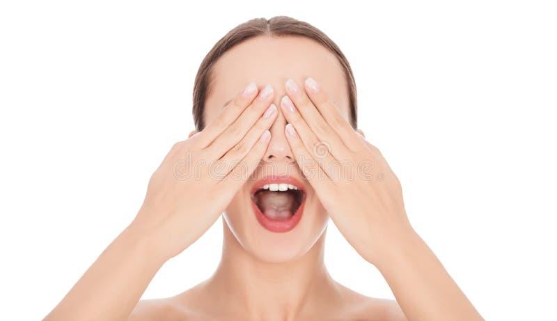 Kvinna med hennes händer på den öppna framsidan och hennes munsned boll arkivfoton
