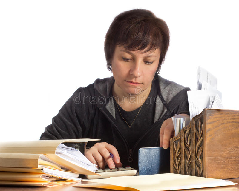 Kvinna med hushållfinanser fotografering för bildbyråer