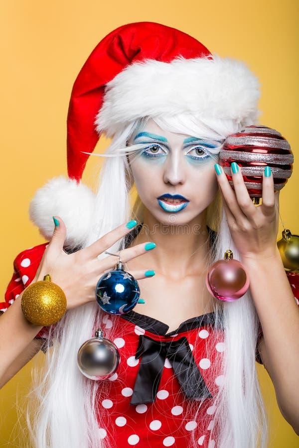 Kvinna med julbollar royaltyfria foton