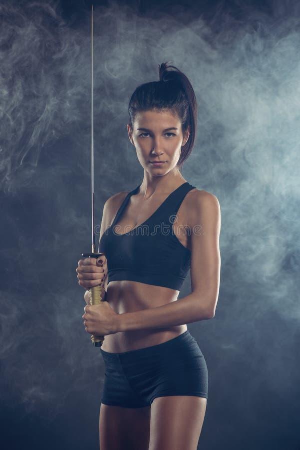 Kvinna med katana royaltyfri foto