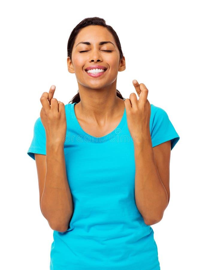 Kvinna med korsade fingrar royaltyfri foto