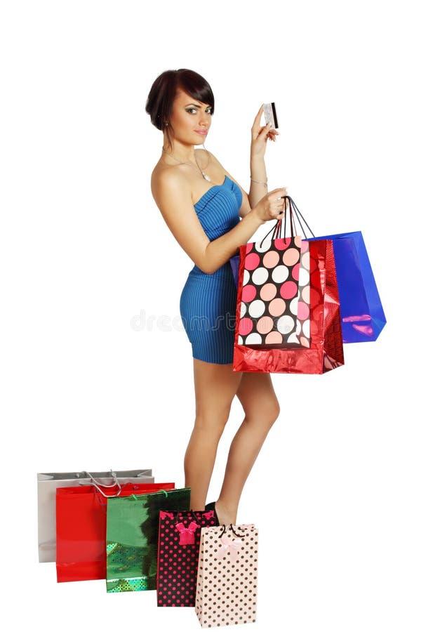 Kvinna med kreditkorten arkivfoto