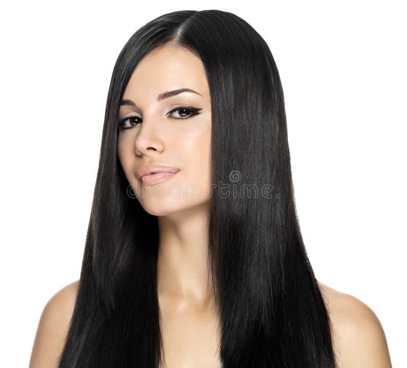 Kvinna med långt rakt hår fotografering för bildbyråer