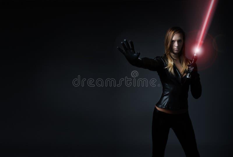 Kvinna med laser-svärdet royaltyfria foton