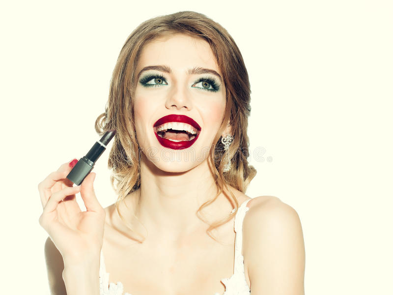 Kvinna med makeupläppstift royaltyfria bilder