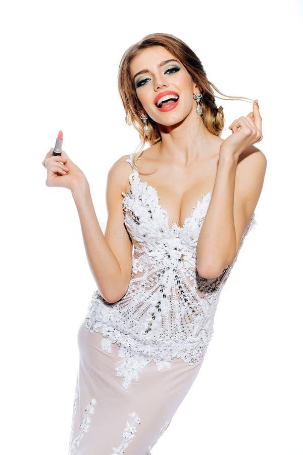 Kvinna med makeupläppstift royaltyfria foton