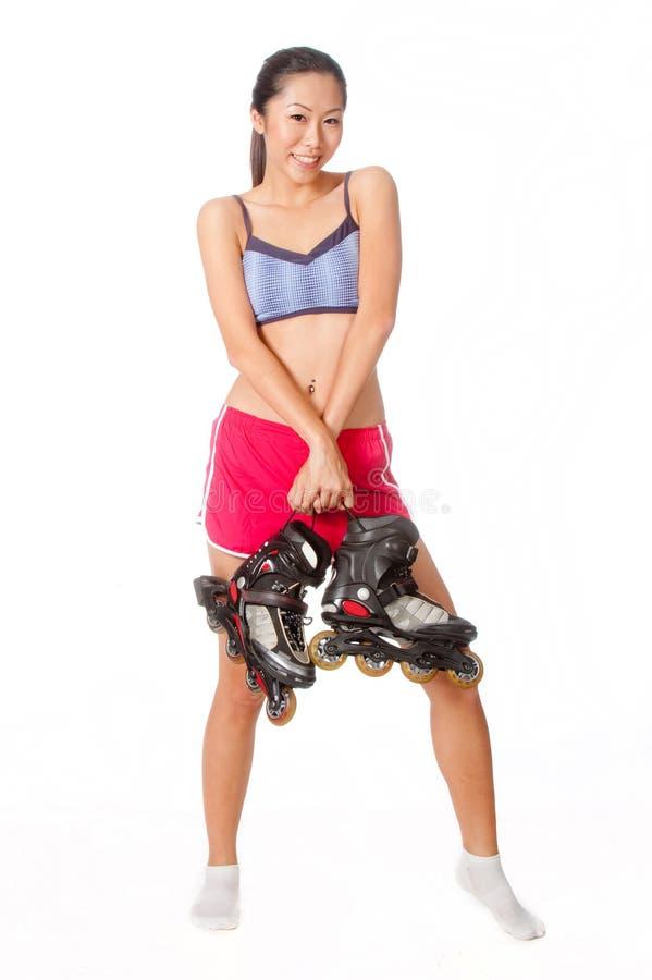 Kvinna med Rollerblade royaltyfri bild