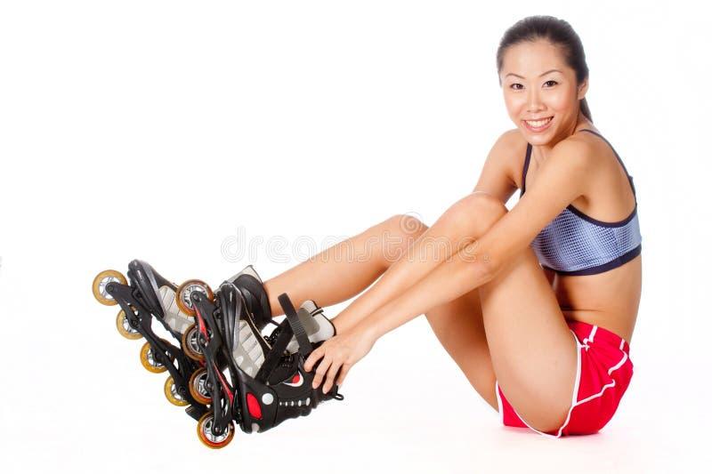 Kvinna med Rollerblade arkivfoton