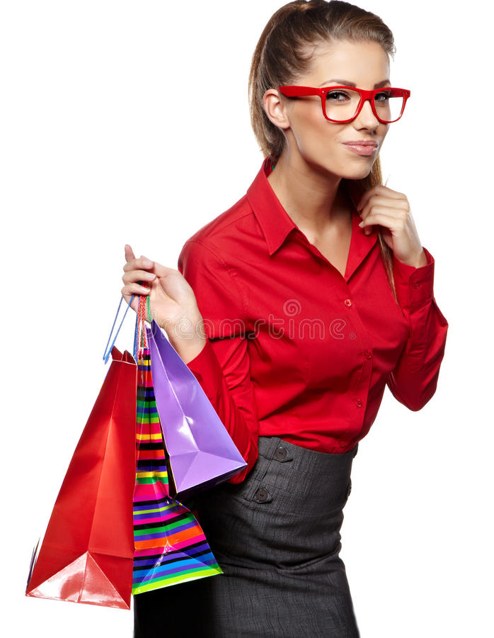 Kvinna med shoppingpåsar arkivbilder