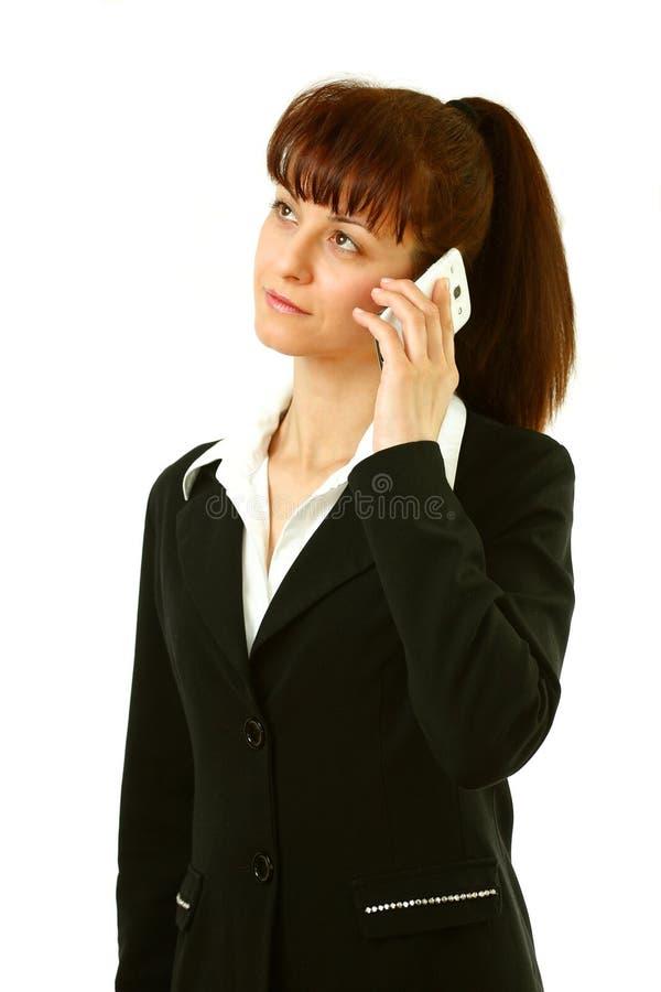 Kvinna med smartphonen arkivfoto