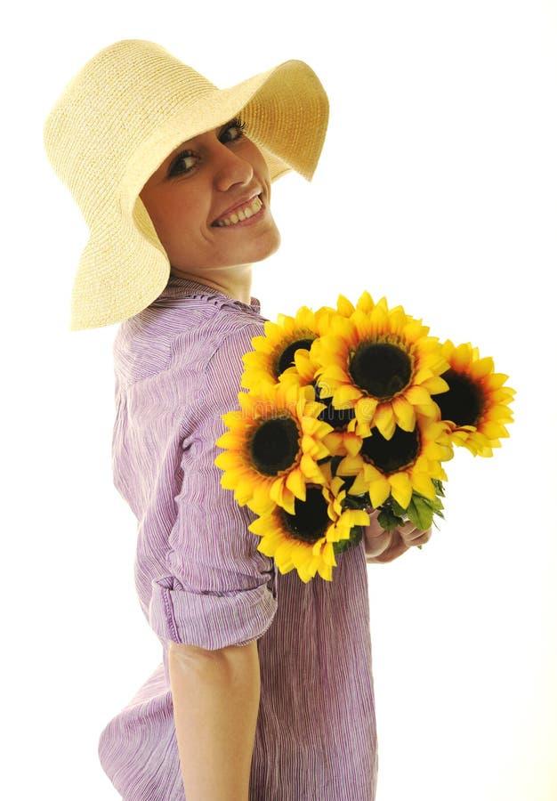 Kvinna med solrosen som isoleras på white fotografering för bildbyråer