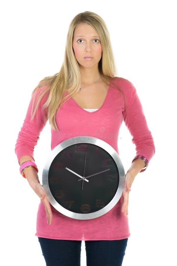 Kvinna med stora klockor royaltyfri bild