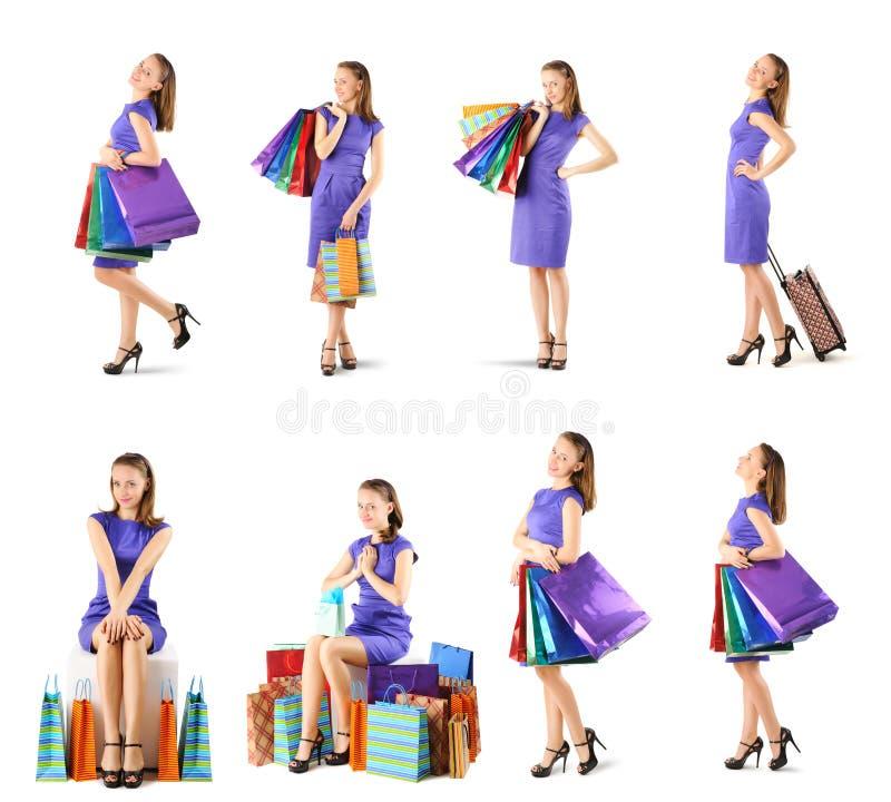 Kvinna med uppsättningen för shoppingpåsar arkivfoton