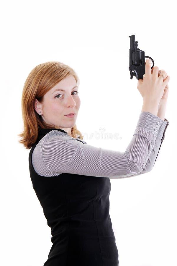Kvinna med vapnet arkivfoton