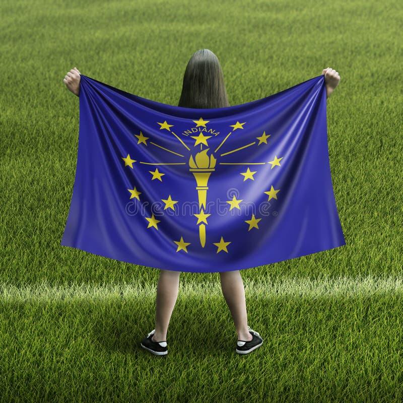 Kvinna- och Indiana flagga arkivfoton