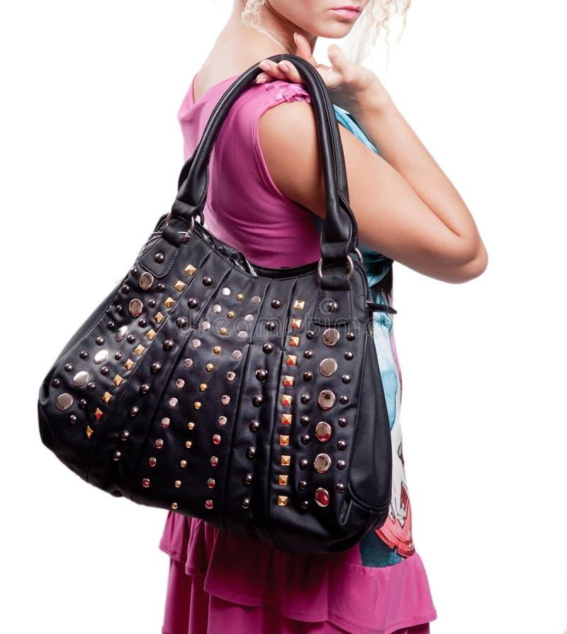 Kvinna och modepåse (handväskan) arkivbild