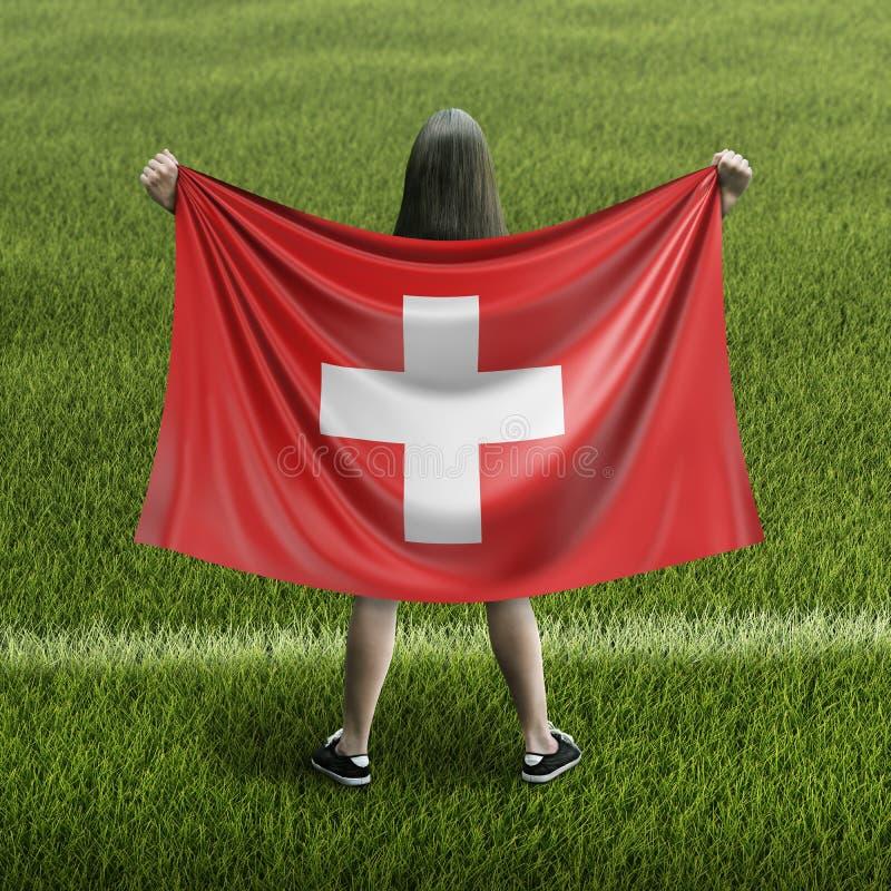 Kvinna- och schweizareflagga royaltyfri foto