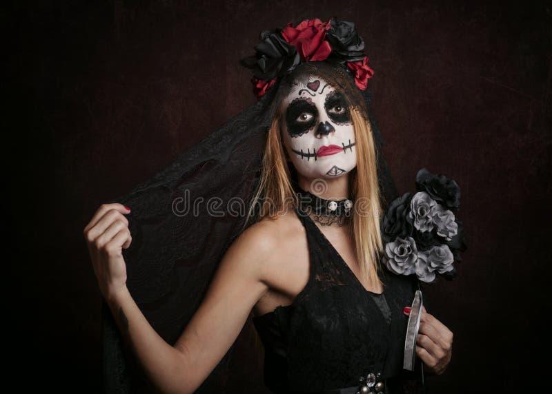 Kvinna på allhelgonaafton arkivfoton
