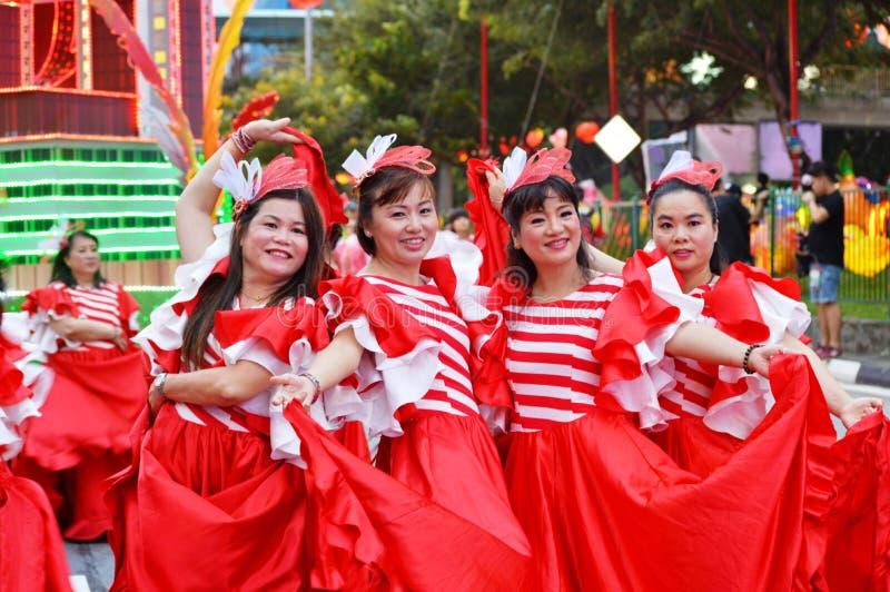 Kvinna` s på kines Chingay Parada, Singapore