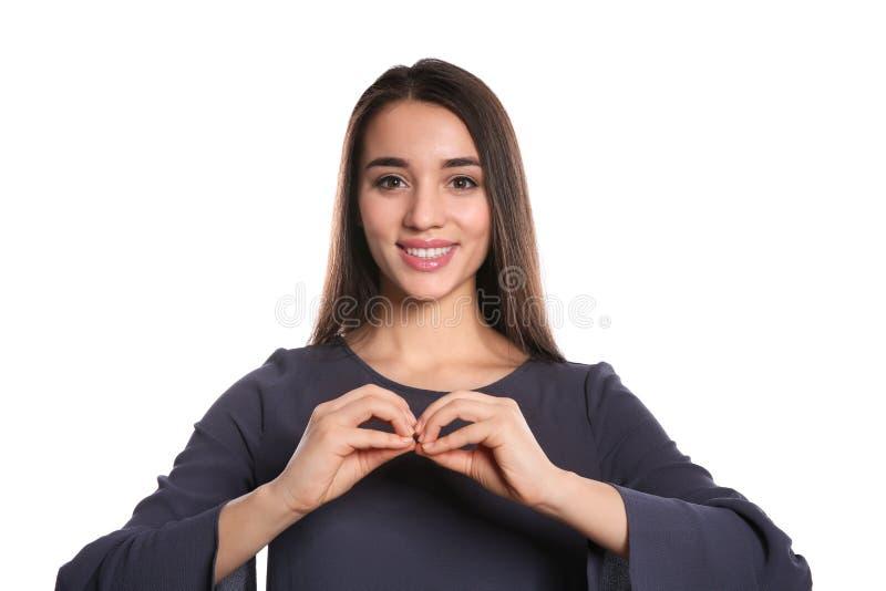 Kvinna som använder teckenspråk på vit arkivbild