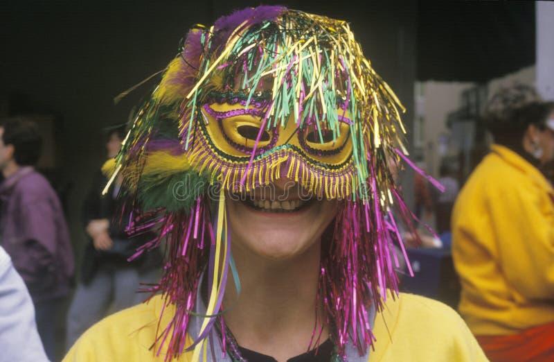 Kvinna som bär Mardi Gras Mask, New Orleans, Louisiana royaltyfri fotografi