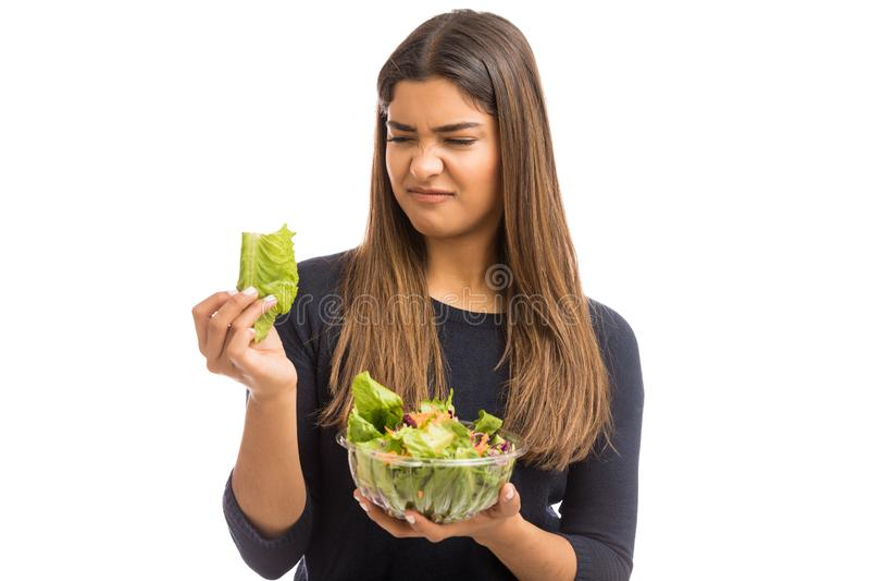 Kvinna som för första gången försöker vård- Foods arkivbilder