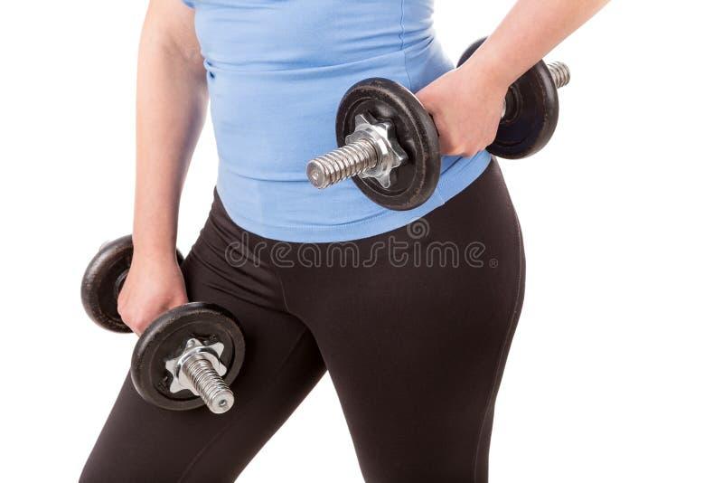 Kvinna som gör kondition för viktförlust arkivfoton