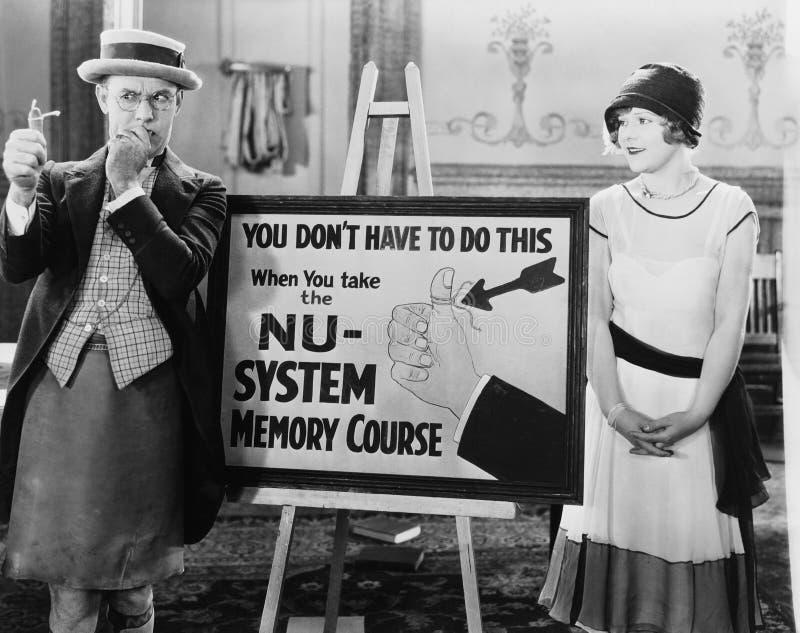 Kvinna som håller ögonen på den fundersamma mannen med rad som binds till hans finger (alla visade personer inte är längre uppehä arkivbild