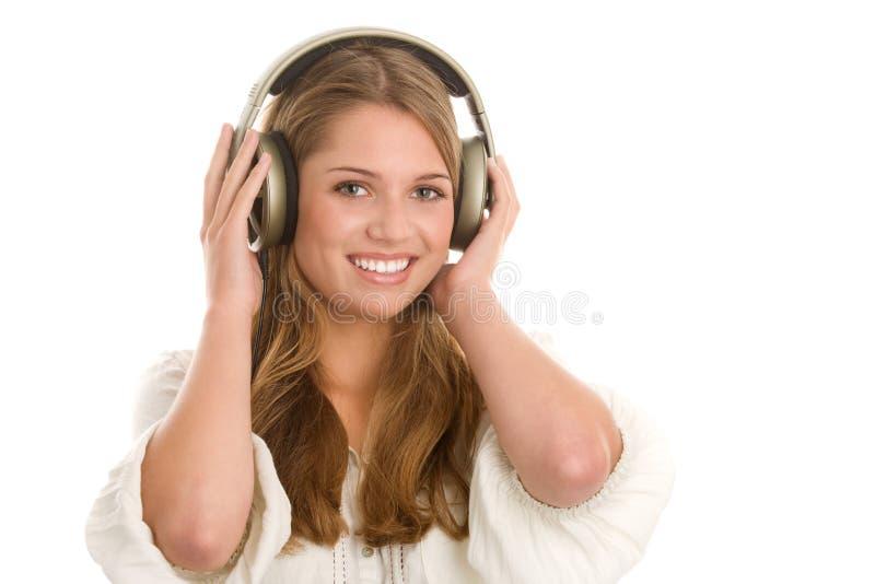 Kvinna som litening till musik royaltyfria foton