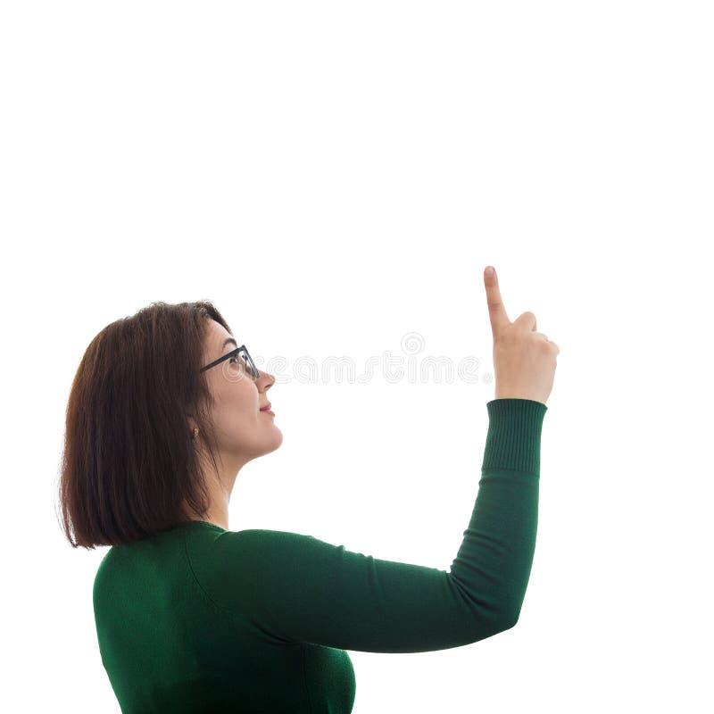 Kvinna som pekar upp fingret fotografering för bildbyråer