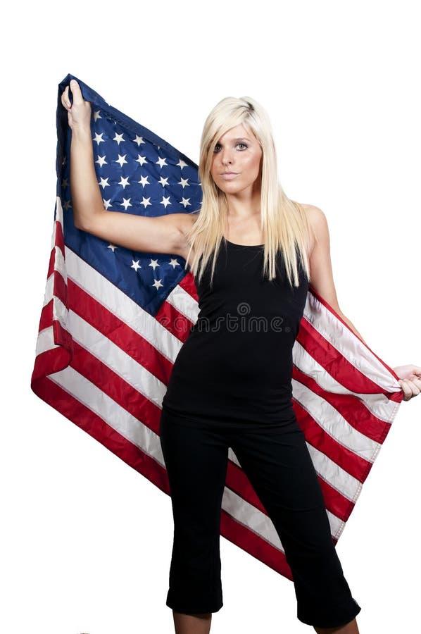 Kvinna Som Slås In I En Flagga Arkivbild