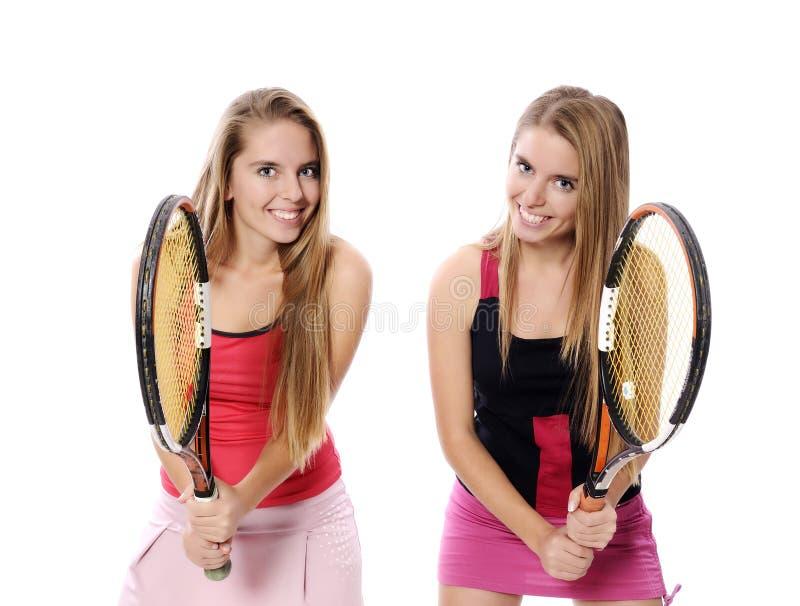 Kvinna som spelar tennis arkivfoto
