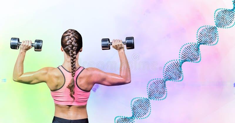 Kvinna som tar vikt med DNAattraktion mot gröna och rosa ljus arkivfoto