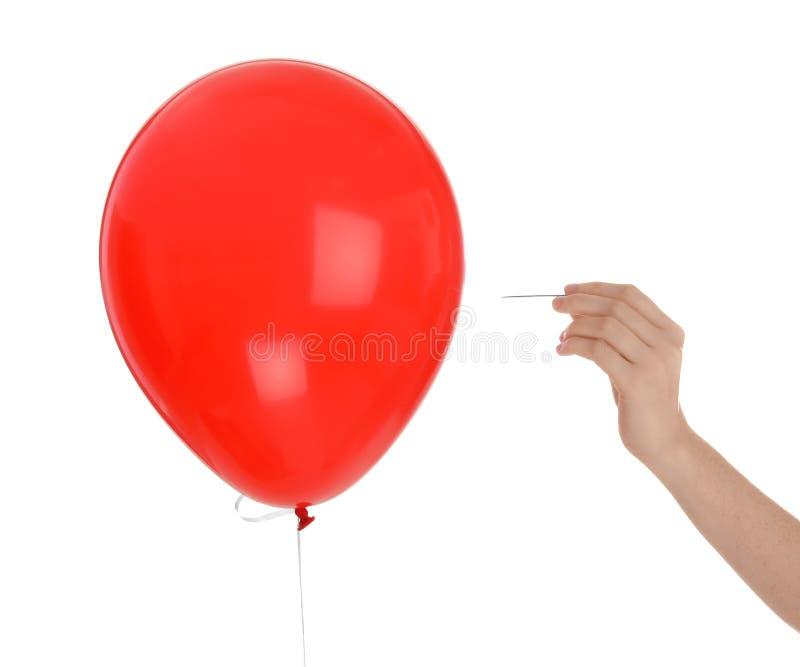 Kvinna som tränger igenom den röda ballongen fotografering för bildbyråer